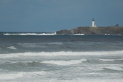 Big waves break near Yaquina Head Lighthouse